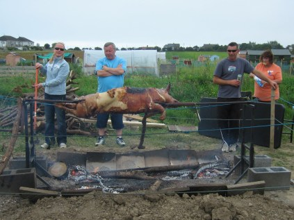 The gang get the pig ready. Photo: Dierdre